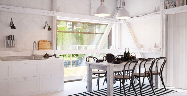 Weiße offene Küche mit Essbereich